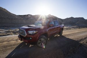 toyota tacoma at sunset in the badlands